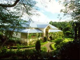 The Falls Rainforest Cottages - Accommodation QLD